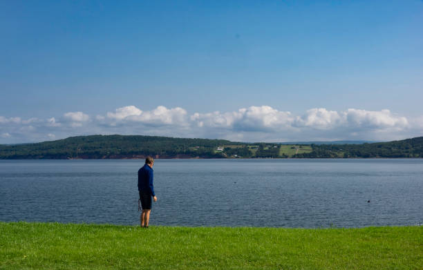 A person looking at the sea. stock photo
