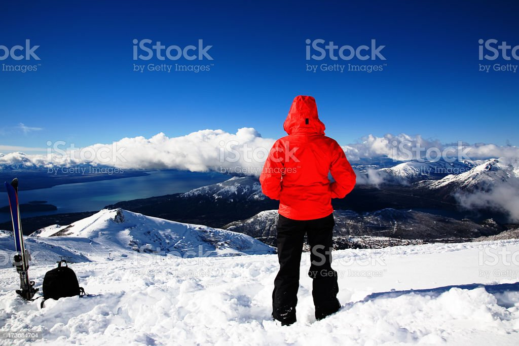 Person looking out over the snowy mountains stock photo