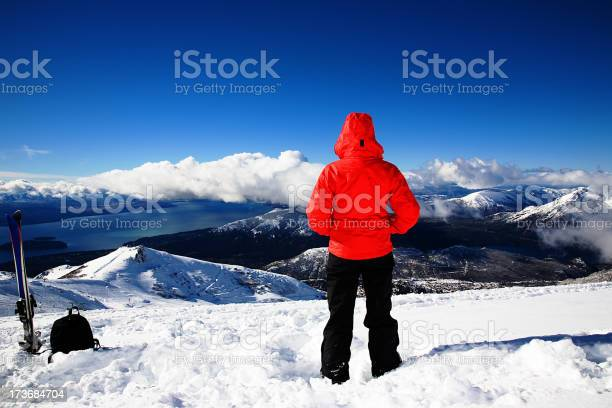 Photo of Person looking out over the snowy mountains