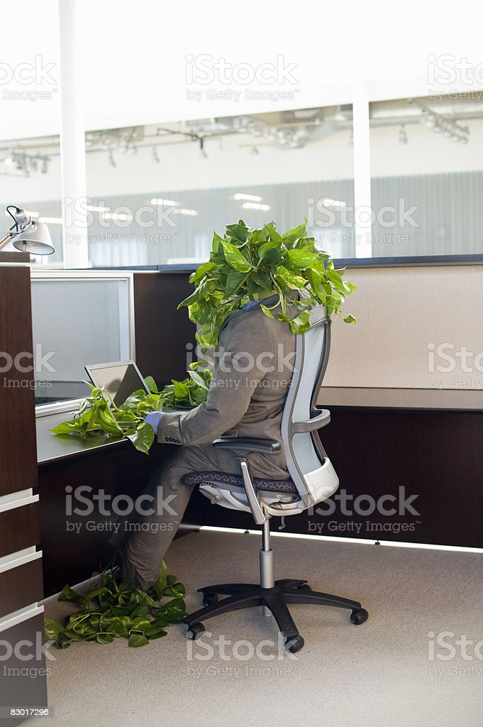 person made of foliage working in office royalty free stockfoto