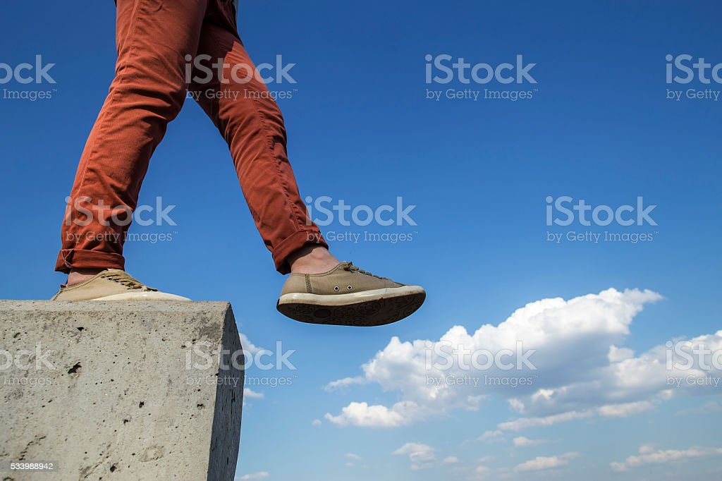 person makes confident step with concrete wall royalty-free stock photo