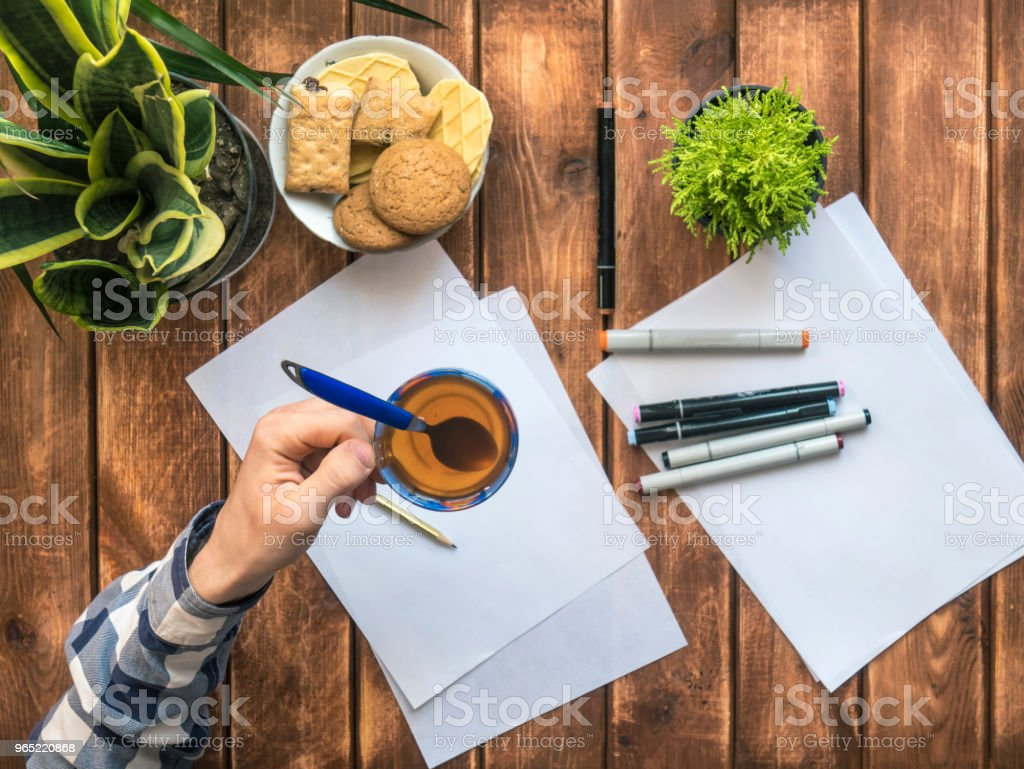 person making a break during working with sketches royalty-free stock photo