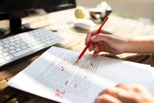 Person Marking Error With Red Marker Close-up Of A Person's Hand Marking Error With Red Marker On Document single word stock pictures, royalty-free photos & images