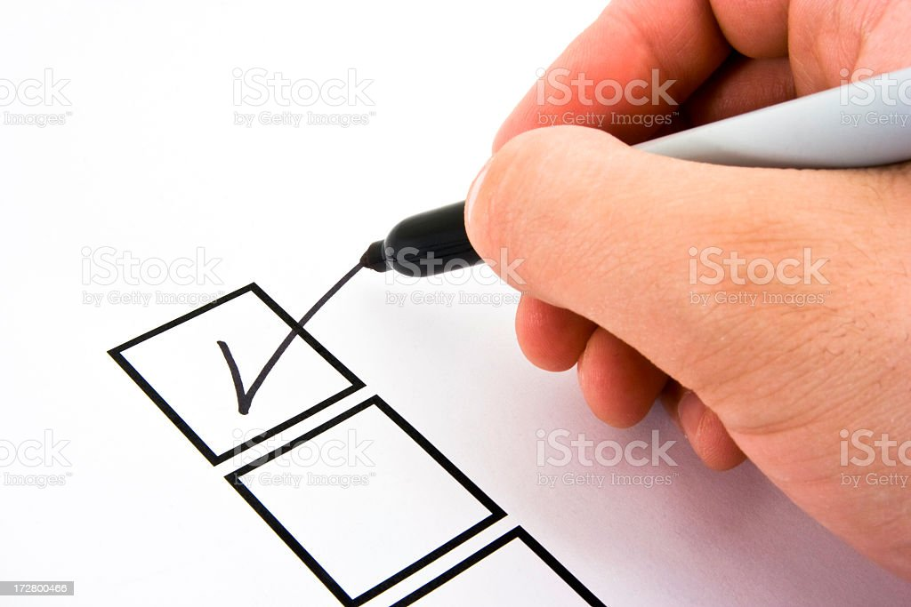 Person Marking in a Checkbox royalty-free stock photo