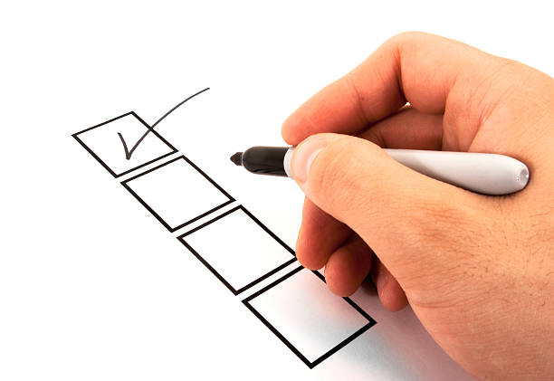 Person Marking in a Checkbox stock photo