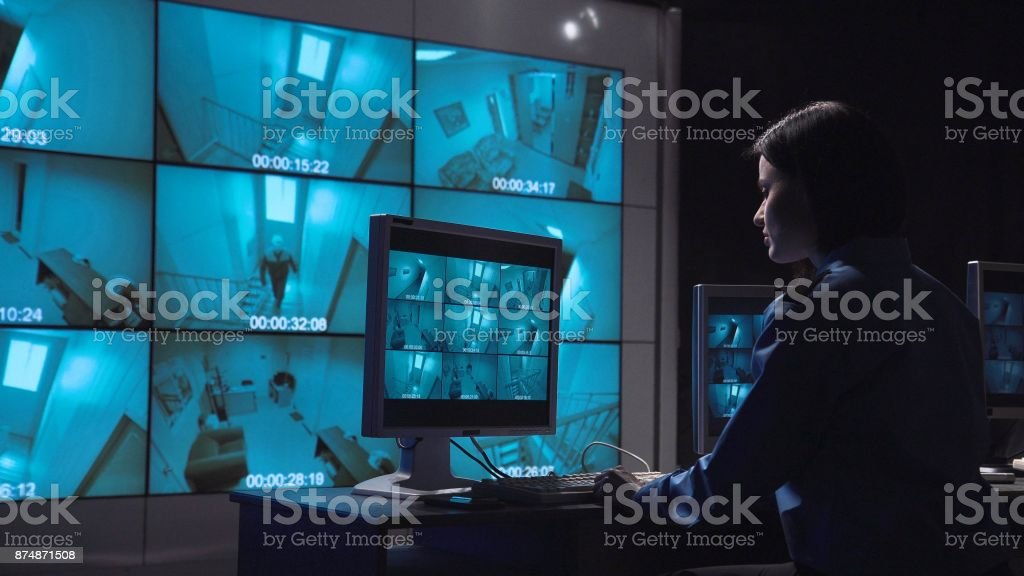 Person monitoring closed circuit surveillance stock photo