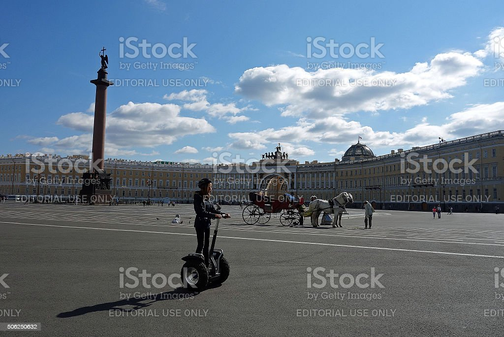 person on a Segway rides through Palace Square stock photo
