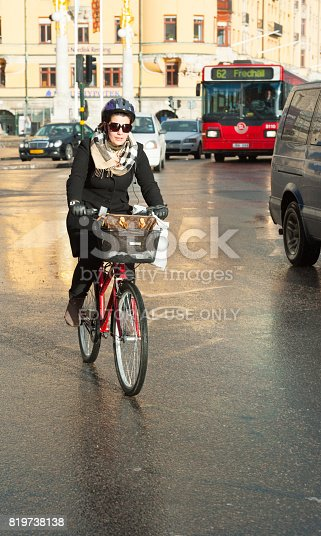 583973114istockphoto Person on bicycle in sun after rain 819738138