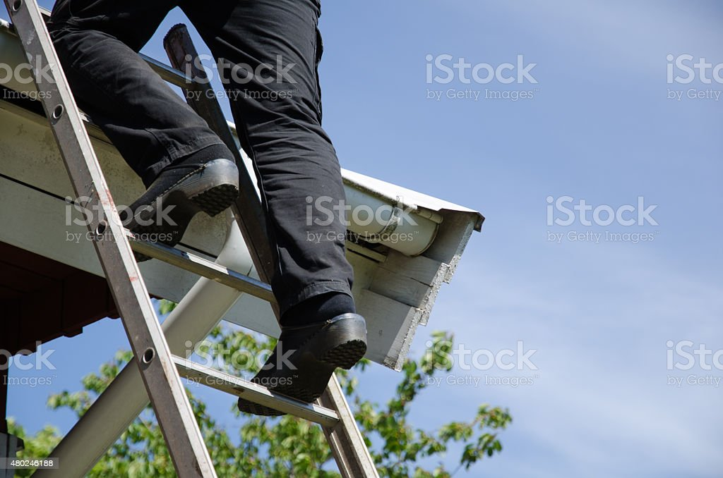 Person on ladder with clogs stock photo