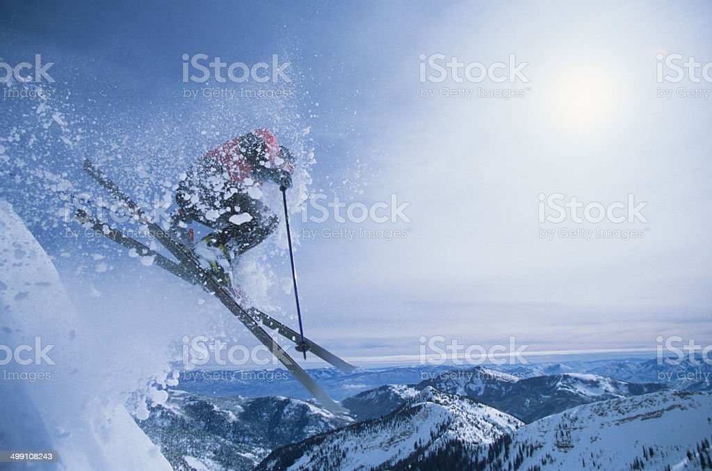 Person On Skis Jumping Over Slope stock photo