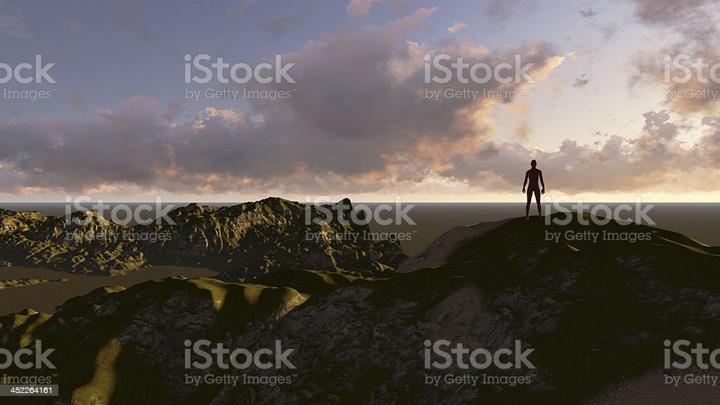 A person on top of a mountain looking into the sky stock photo