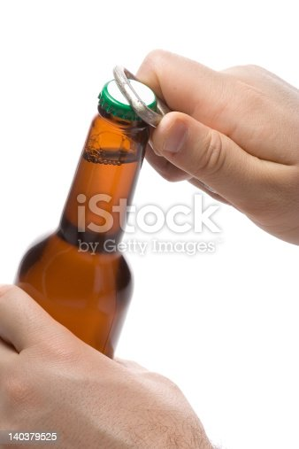 Person opening a bottle of beer against white background