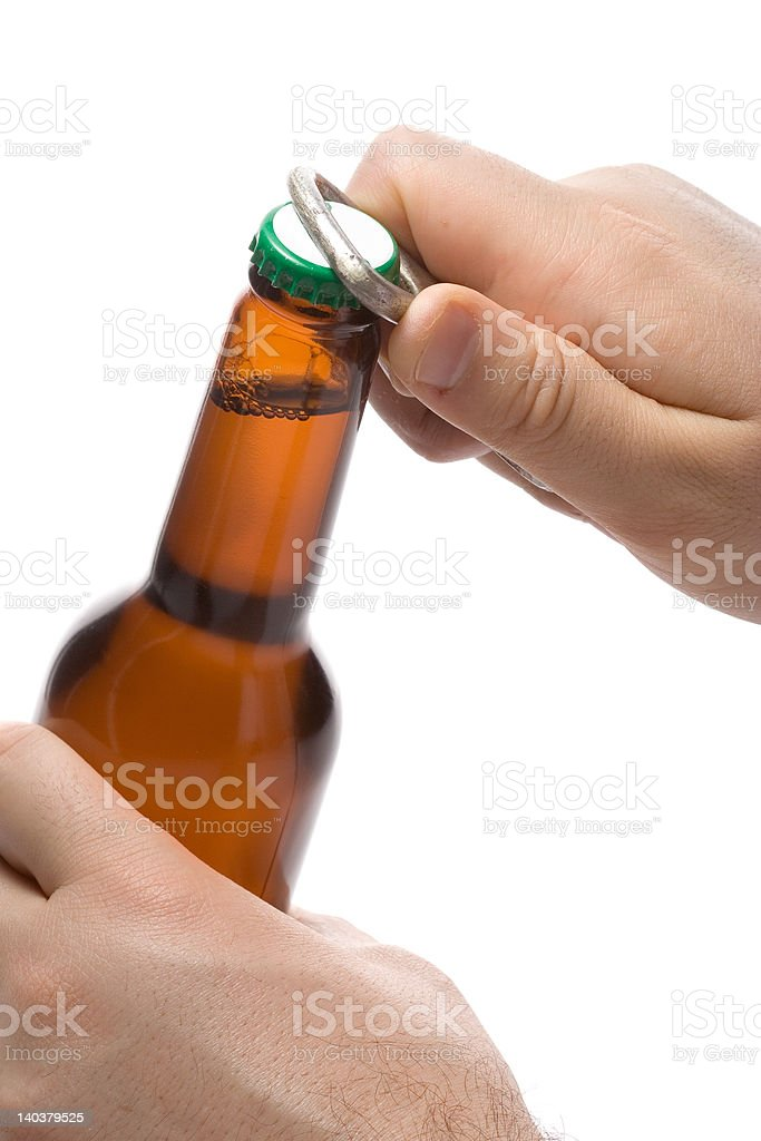 Person opening a bottle of beer stock photo