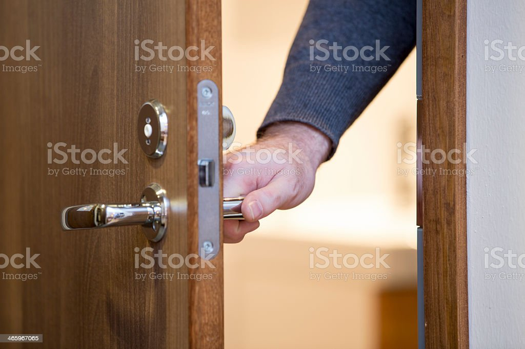 A person opening a wooden door stock photo & Royalty Free Closing Door Pictures Images and Stock Photos - iStock