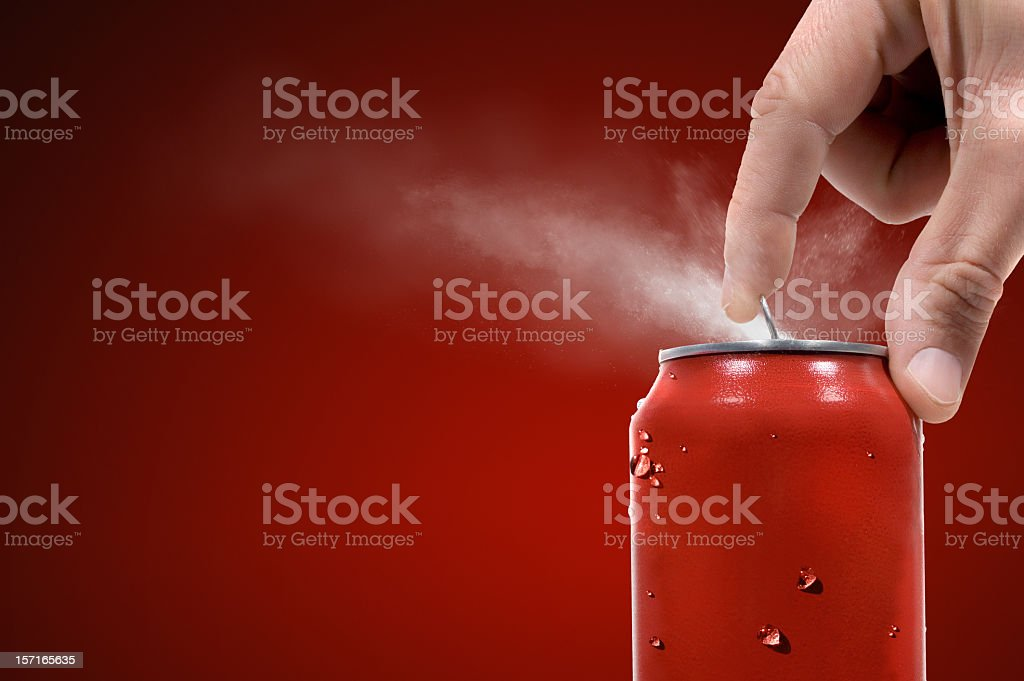 Person opening can of carbonated beverage royalty-free stock photo