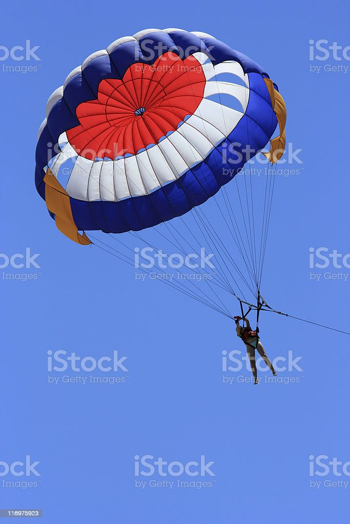 A person parasailing in a big blue sky royalty-free stock photo