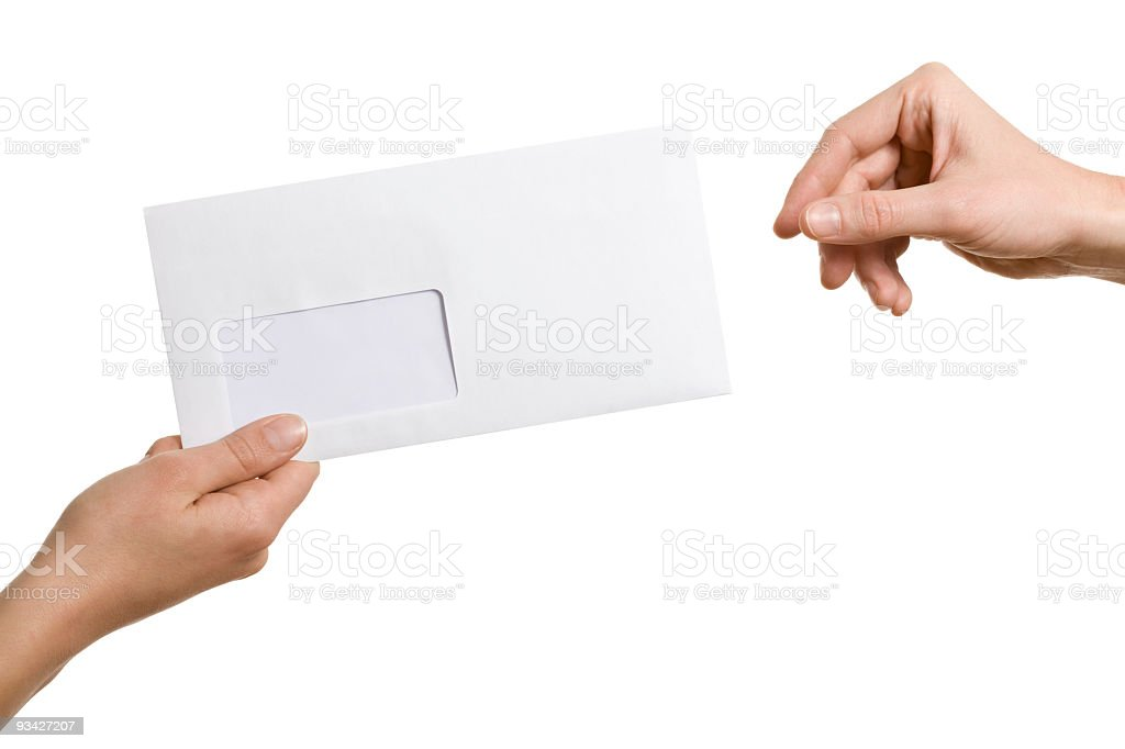 A person passing an envelope to another person stock photo