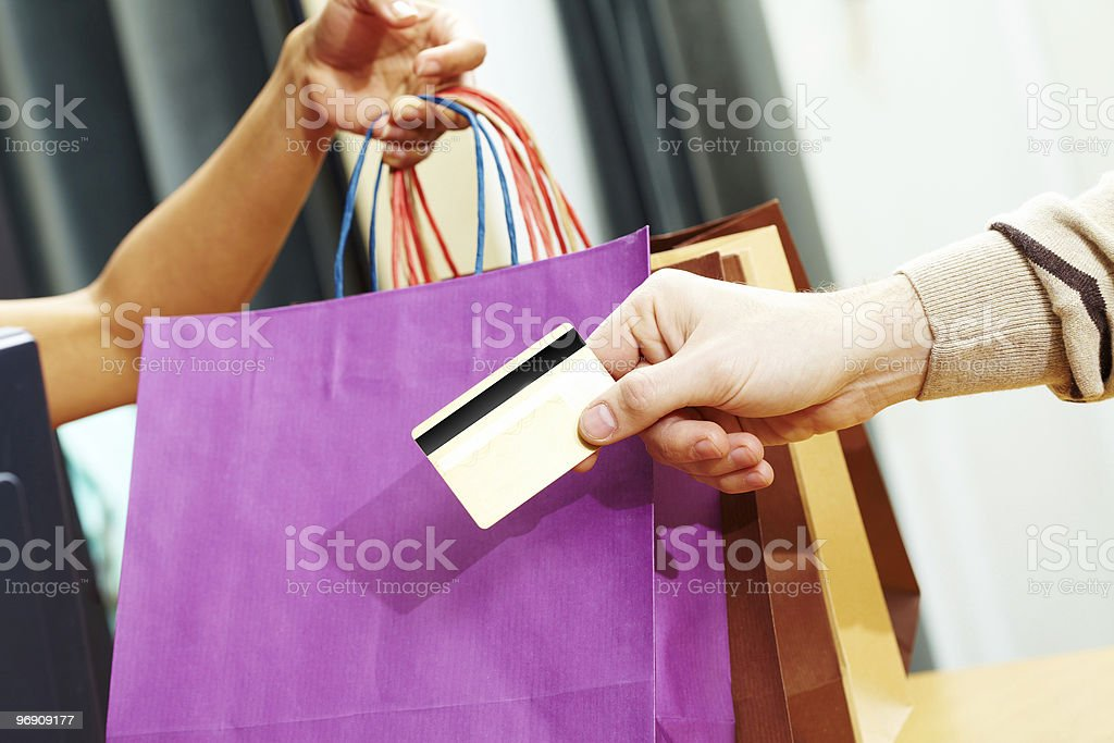 Person paying for shopping with credit card royalty-free stock photo