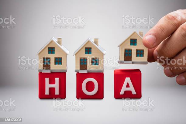 Person placing the miniature houses on red hoa blocks picture id1185170023?b=1&k=6&m=1185170023&s=612x612&h=u3pduknx476gh4qzkcnmgiu8 d  y9i8w2czaoagmv4=