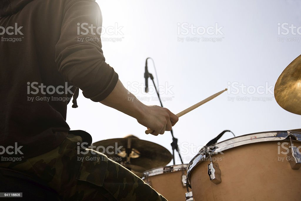 Person playing drums outside on nice day  stock photo