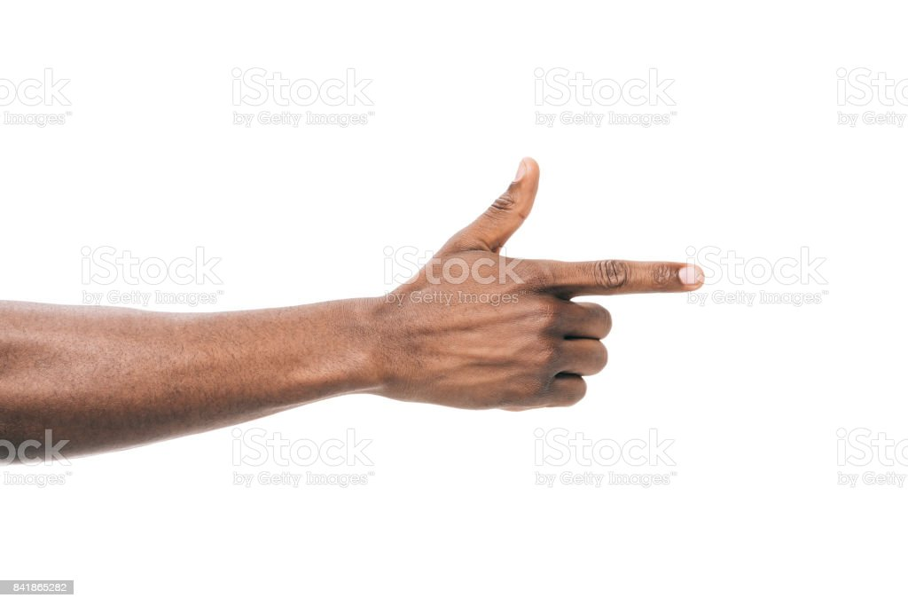 person pointing away with finger stock photo