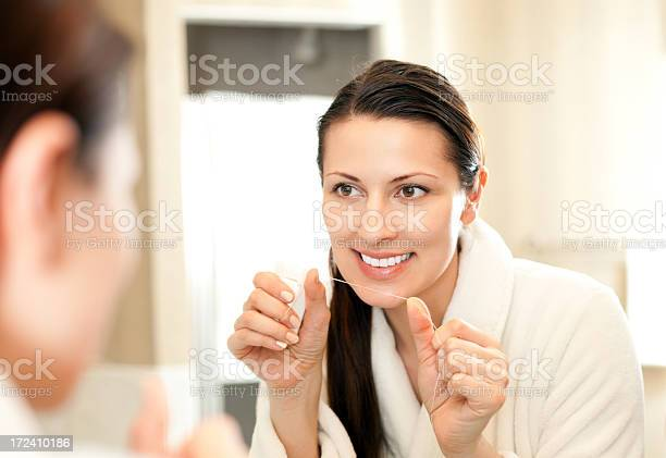 Person Practicing Good Dental Hygiene Early Morning Stock Photo - Download Image Now
