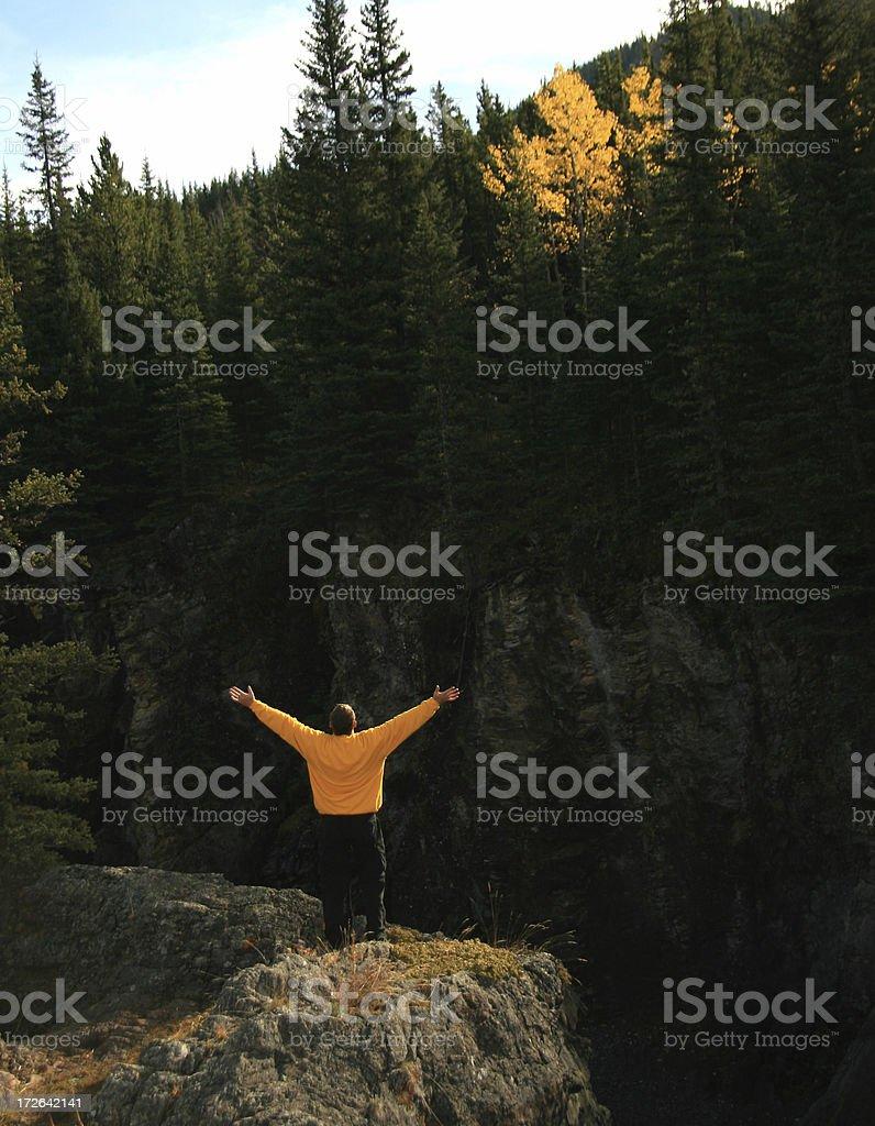 Person praising on a mountain. royalty-free stock photo
