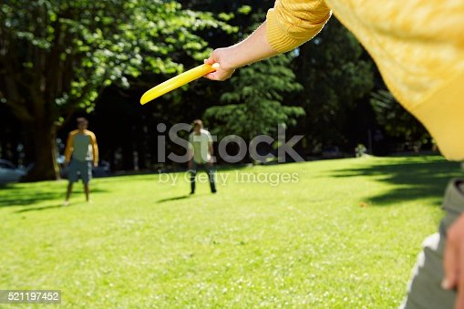 620402800istockphoto Person preparing to throw a flying disc 521197452