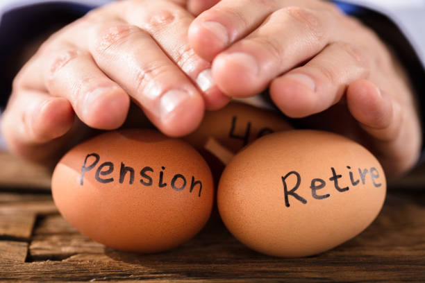 Person Protecting Egg Showing Pension And Retirement Text Close-up Of A Person's Hand Protecting Brown Egg Showing Pension And Retirement Text 40 kilometre stock pictures, royalty-free photos & images