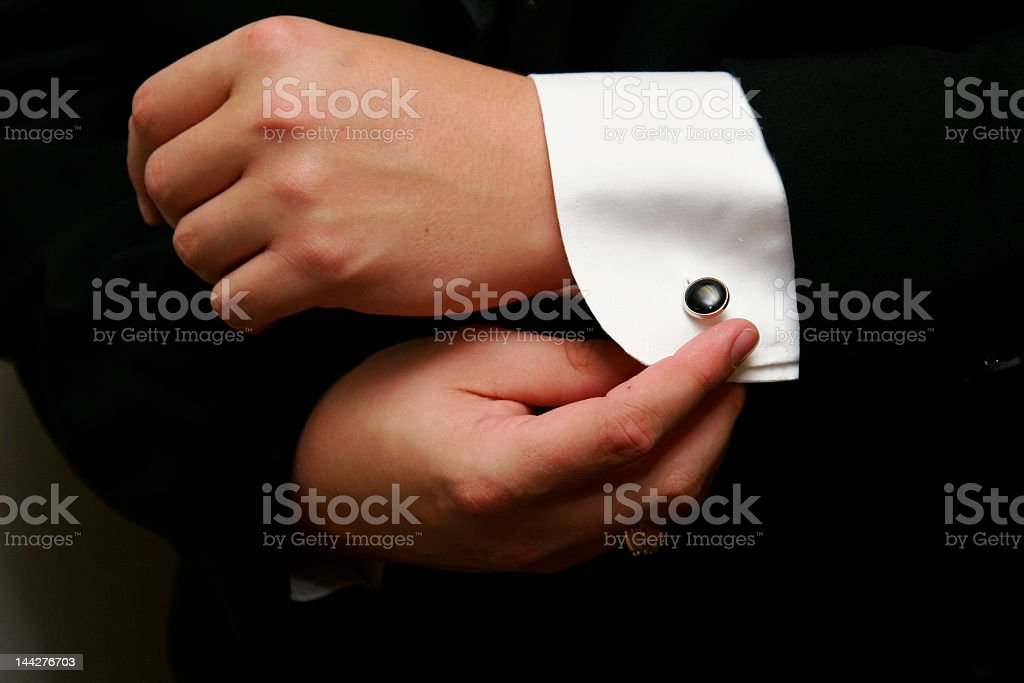 Person putting finishing cuffs on sleeve stock photo