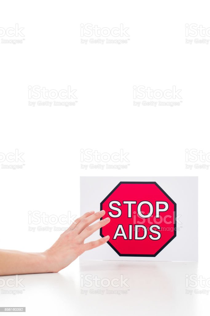 person reaching for stop aids banner stock photo