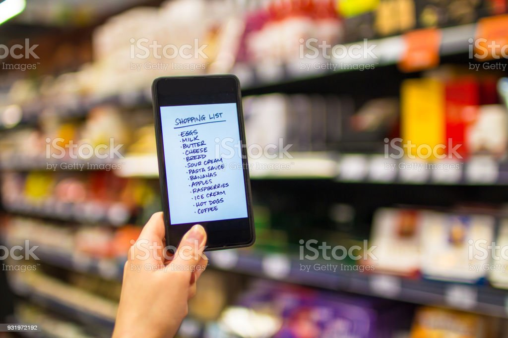 Person reading shopping list on smartphone