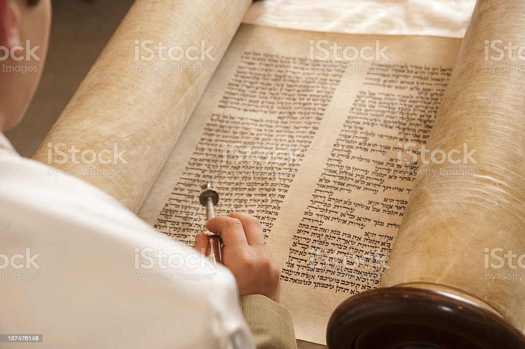 Person reading the historic words of the Torah stock photo