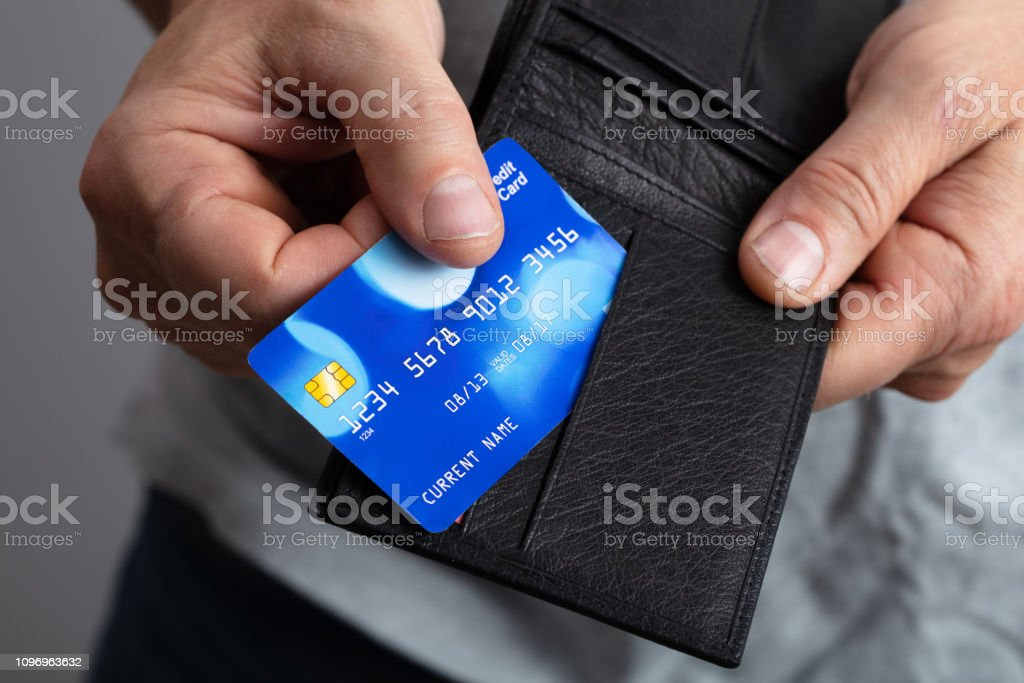 Selective Focus Of A Person\'s Removing Credit Card From Wallet
