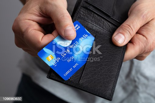 Selective Focus Of A Person's  Removing Credit Card From Wallet