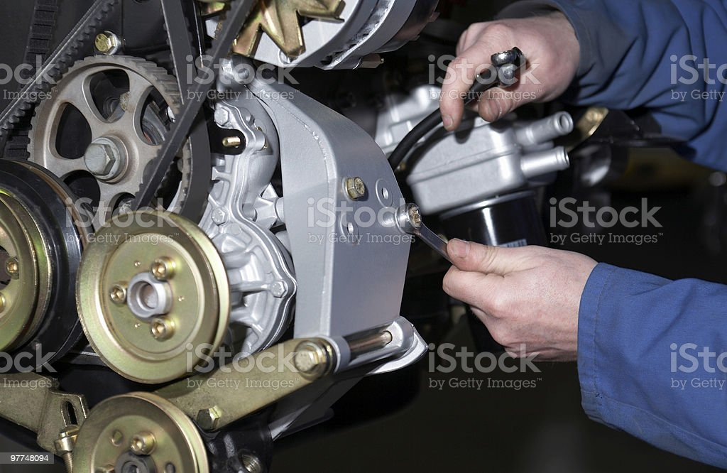 A person repairing a motor vehicle stock photo