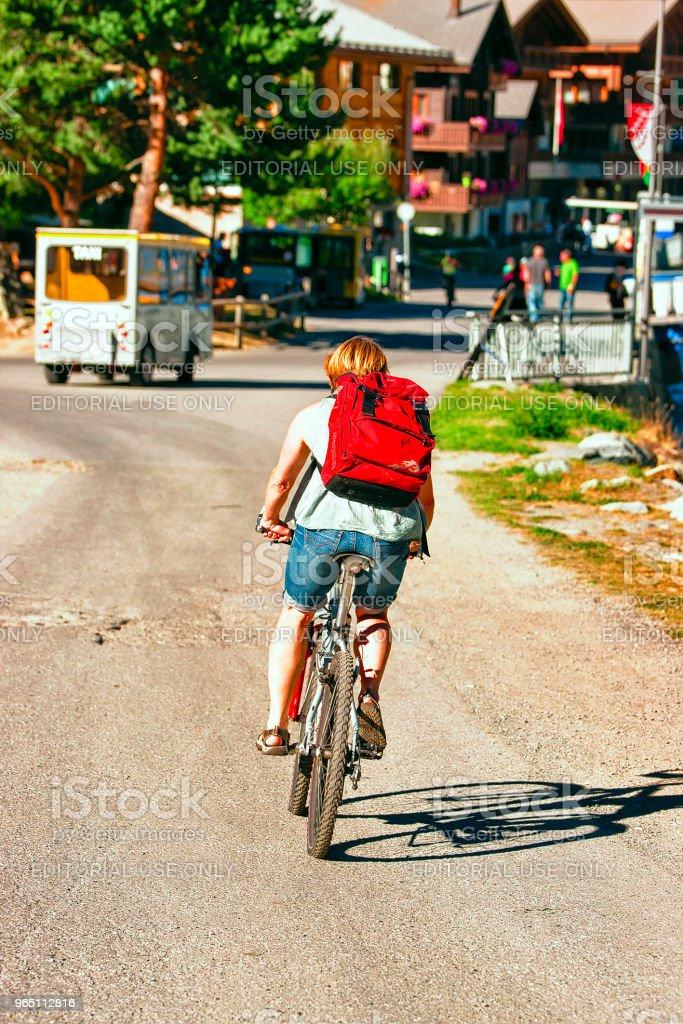 Person riding bicycle in resort city in Switzerland CH zbiór zdjęć royalty-free