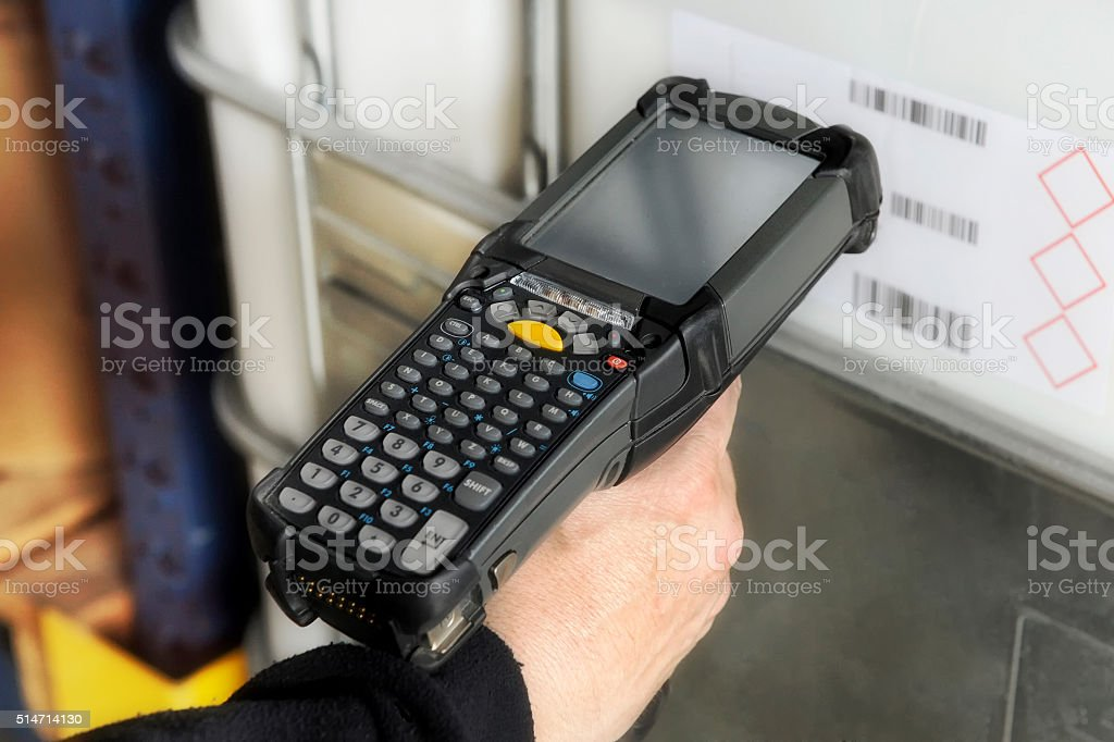 Person scanning a barcode with a scanner stock photo