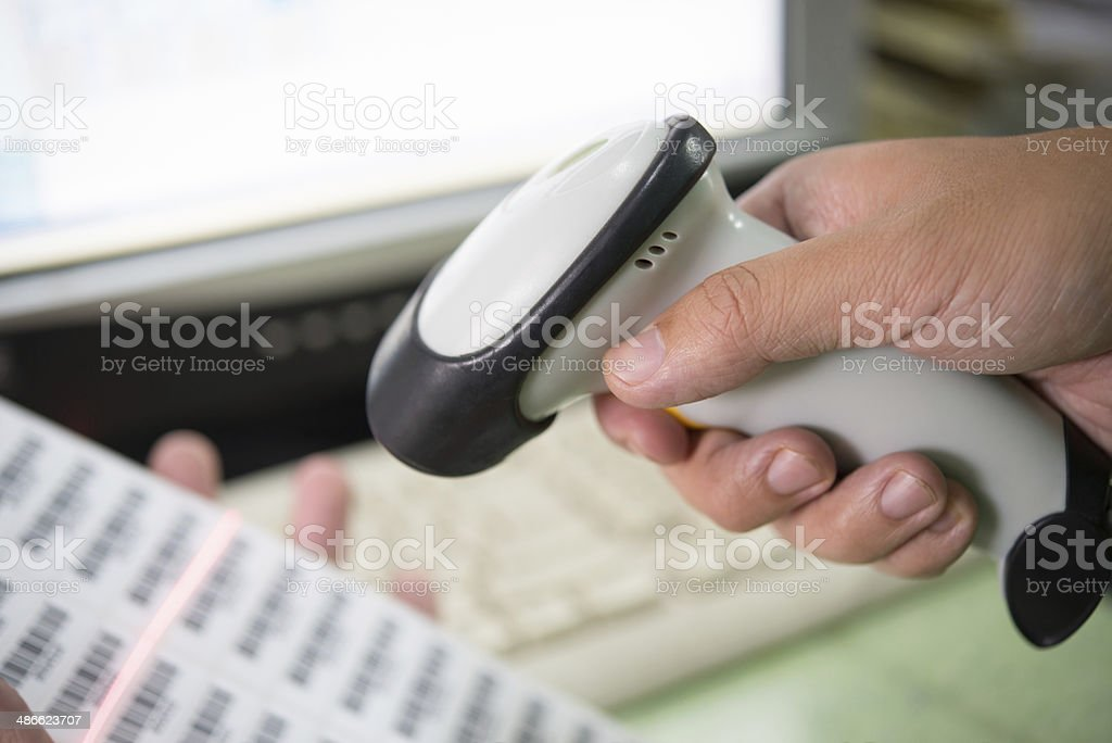 Person Scanning Barcode stock photo