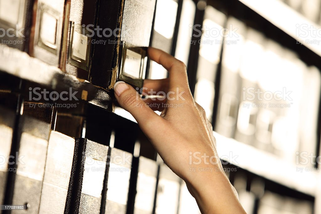 A person searching among archives  stock photo