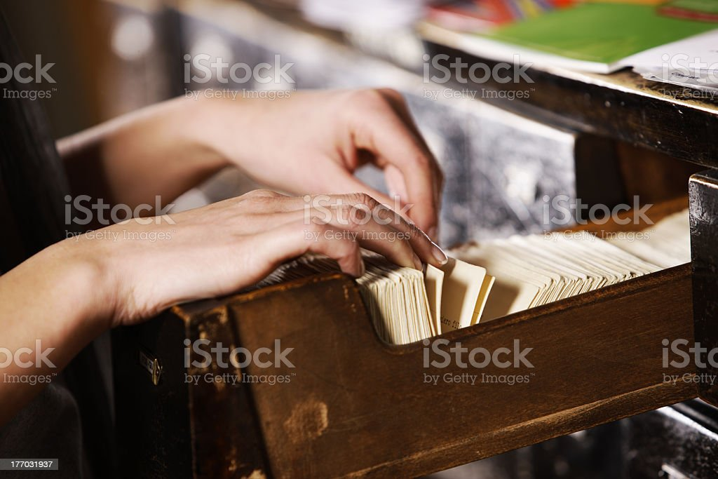 Person searching through archives in library stock photo