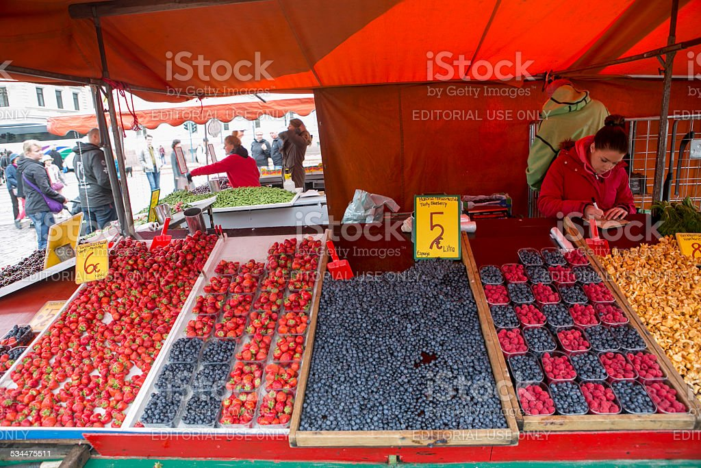 person selling fresh fruit by market square at helsinki finland stock photo
