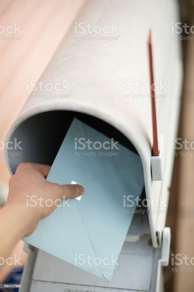 Person sending an envelope and putting in mailbox royalty-free stock photo