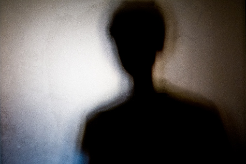 person shadows with Frosted glass - violations concept