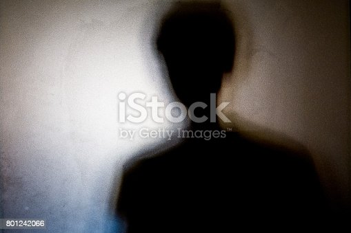 istock person shadows with Frosted glass - violations concept 801242066