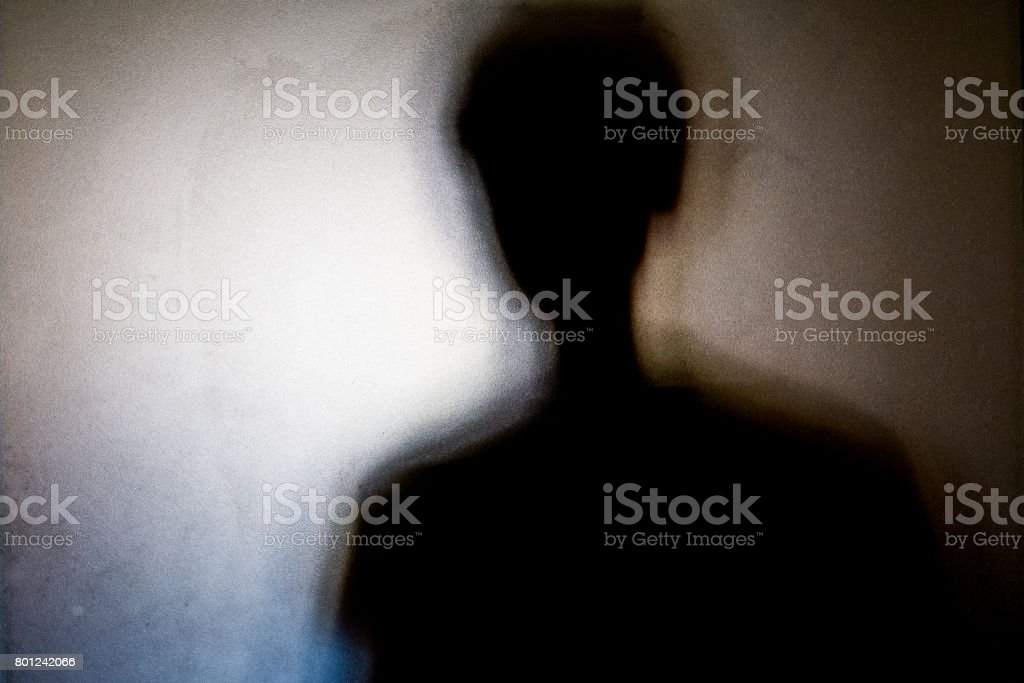 person shadows with Frosted glass - violations concept stock photo