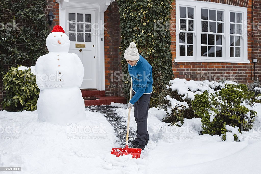 Person shoveling snow royalty-free stock photo