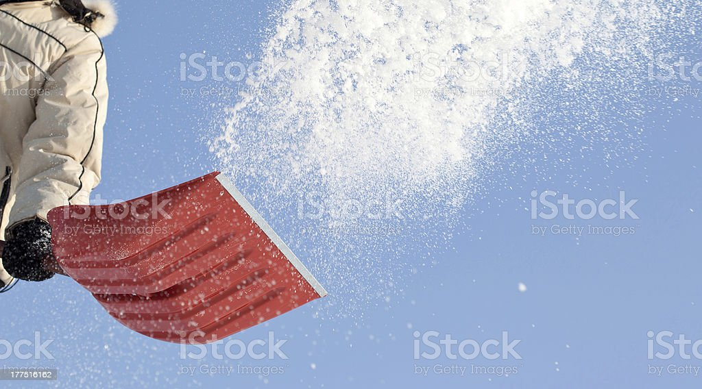 Person shoveling the snow in winter stock photo