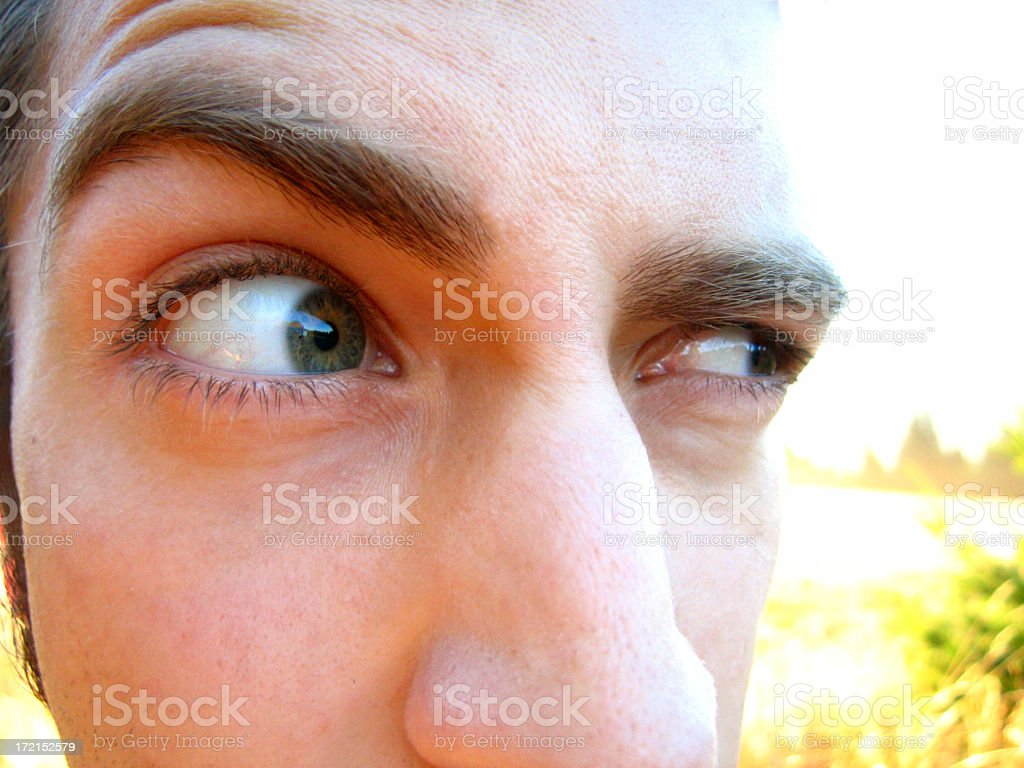 A person showing their suspicious eyes stock photo