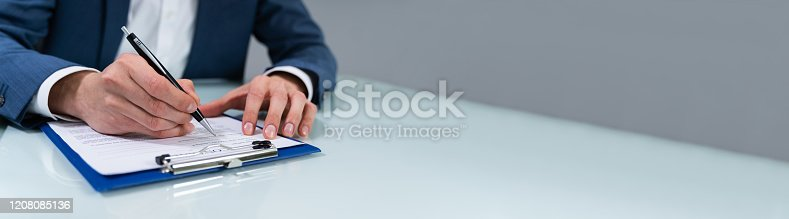 istock Person Signing Contract 1208085136